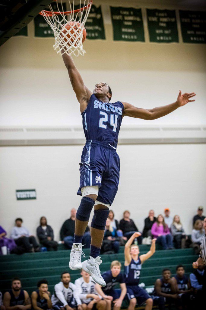 Kobe Burse glides in for the Mona Shores dunk in the fourth quarter to put the Sailors up 60-52. Photo/Tim Reilly