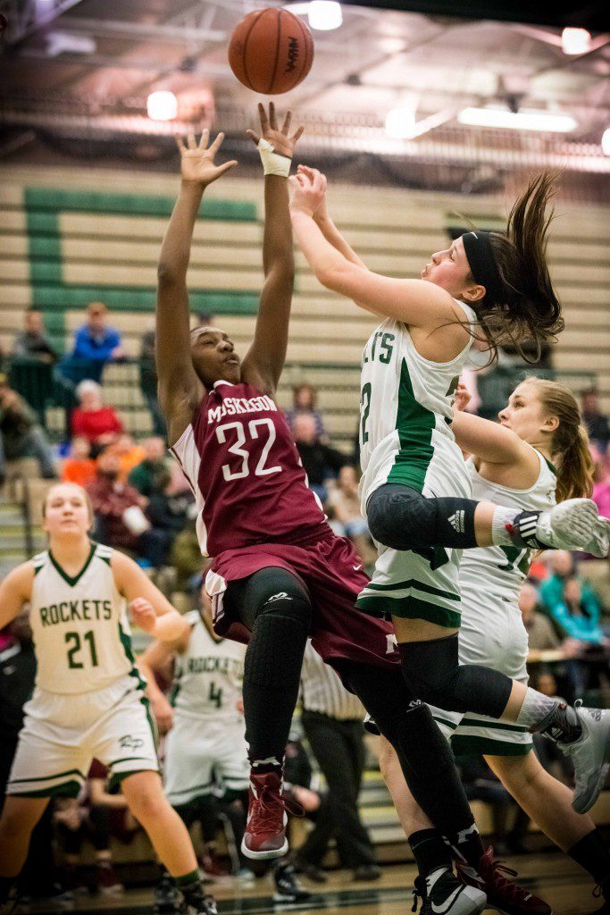 Muskegon's Diynasti Dowell goes for the ball against the Rocketes' No. 32 Elysia Mattos. Photo/Tim Reilly