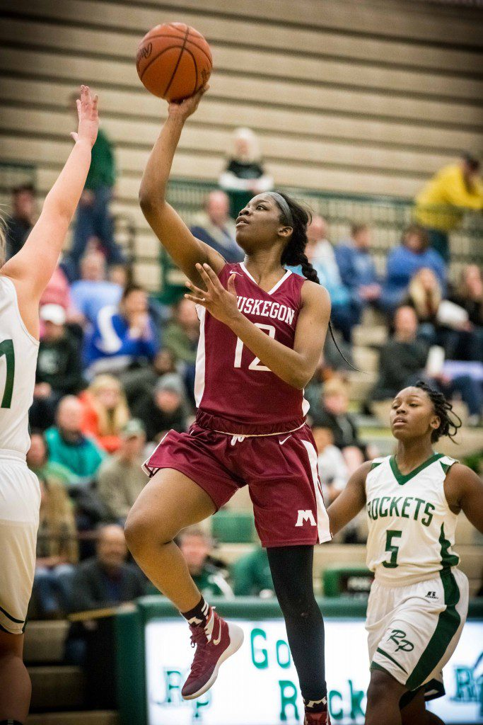 Mardrekia Cook goes in for two points for the Big Reds. Photo/Tim Reilly