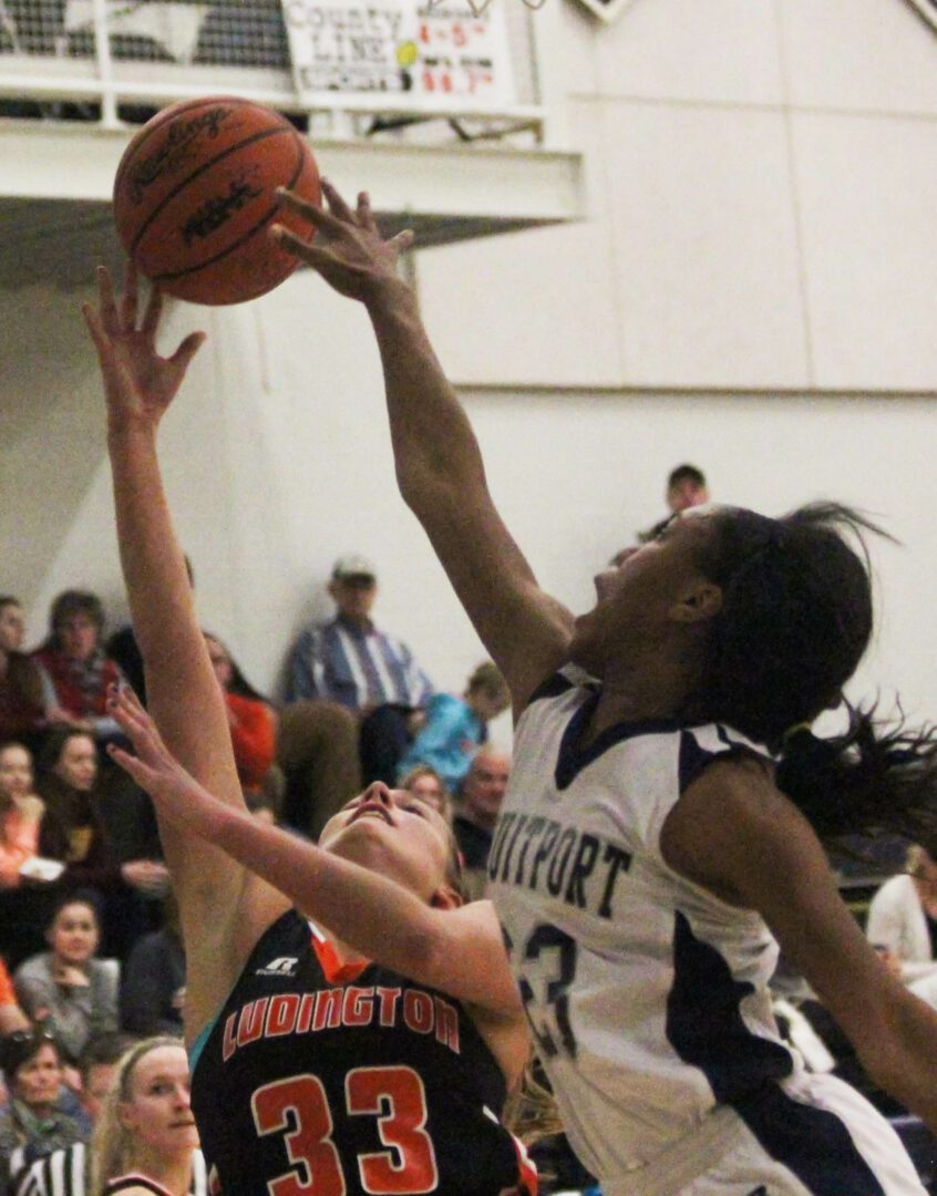 Iyana Brown on the blocked shot for Fruitport. Photo/Grand Haven Tribune