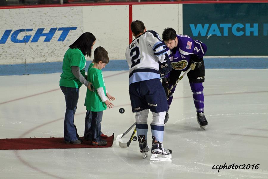 Mitch Eliot takes the honorary puck drop against Madison's Ryan Lohin. Photo/Carol Cooper