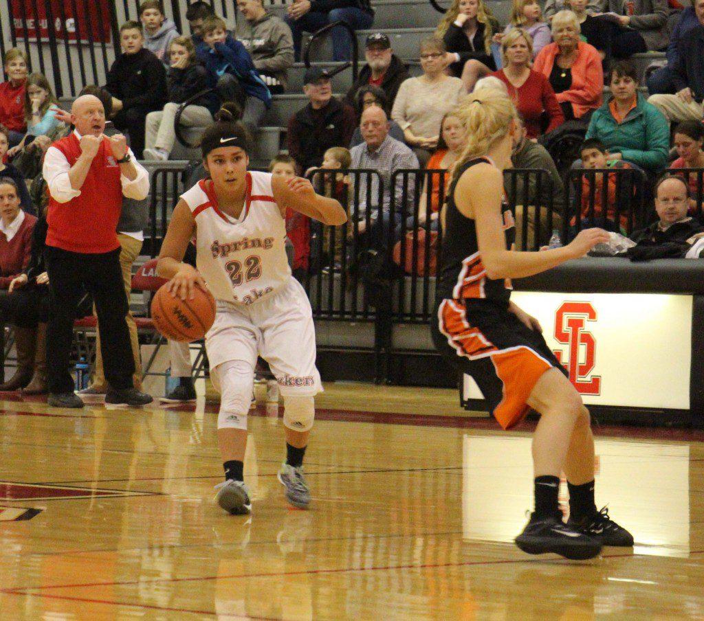 Reiko Johnson dibbles the ball at half court for Spring Lake. Photo/Jason Goorman