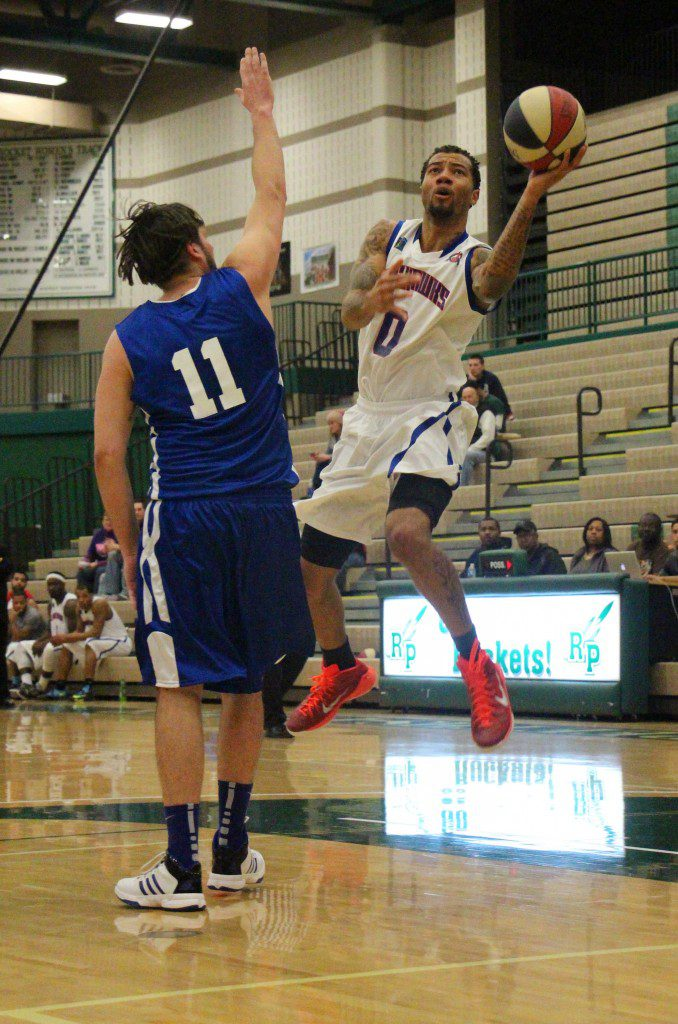 Josh Langford gets in for the layup in a game at Reeths-Puffer High School on February 6.