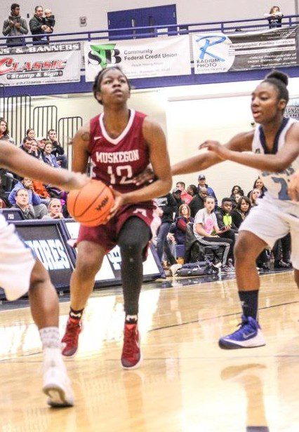 Muskegon standout and Ms. Basketball candidate Mardrekia Cook is guarded by Mona Shores Shamara Tumblin