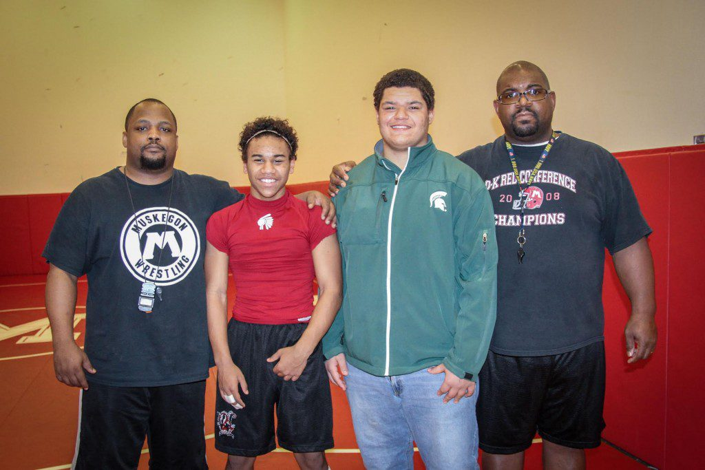Muskegon wrestling coach Chandar Ricks (far right) stands with heavy weight Dovell Wilson and the spry Marcus Murar along with JV coach Shaun Crowley. Photo/Joe Lane
