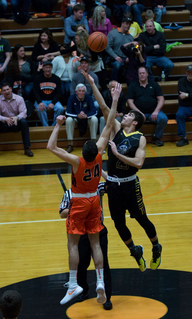 Michael Peterson (24) takes the first jump ball of the game.
