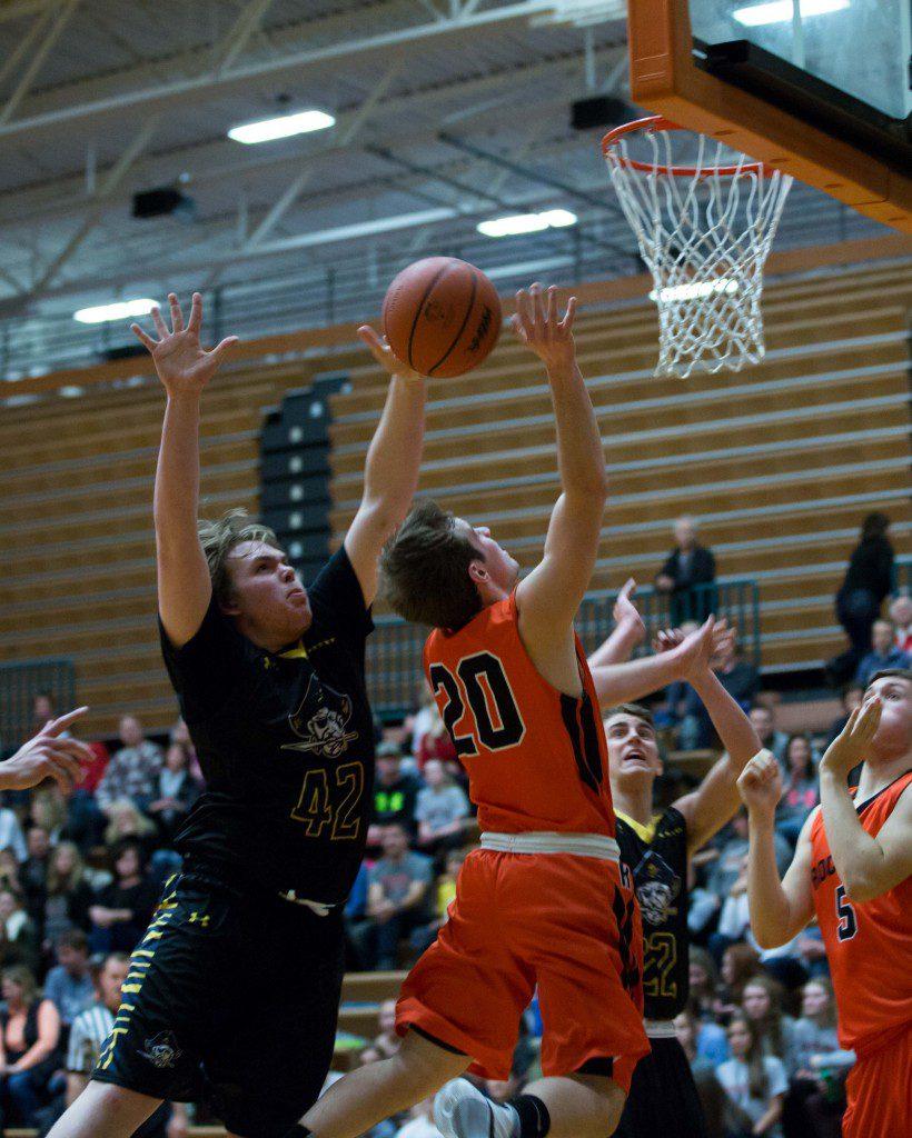 Zach Sinke blocks Rockford's Jason Majerle on the drive to the basket. Photo/Kevin Sielaff