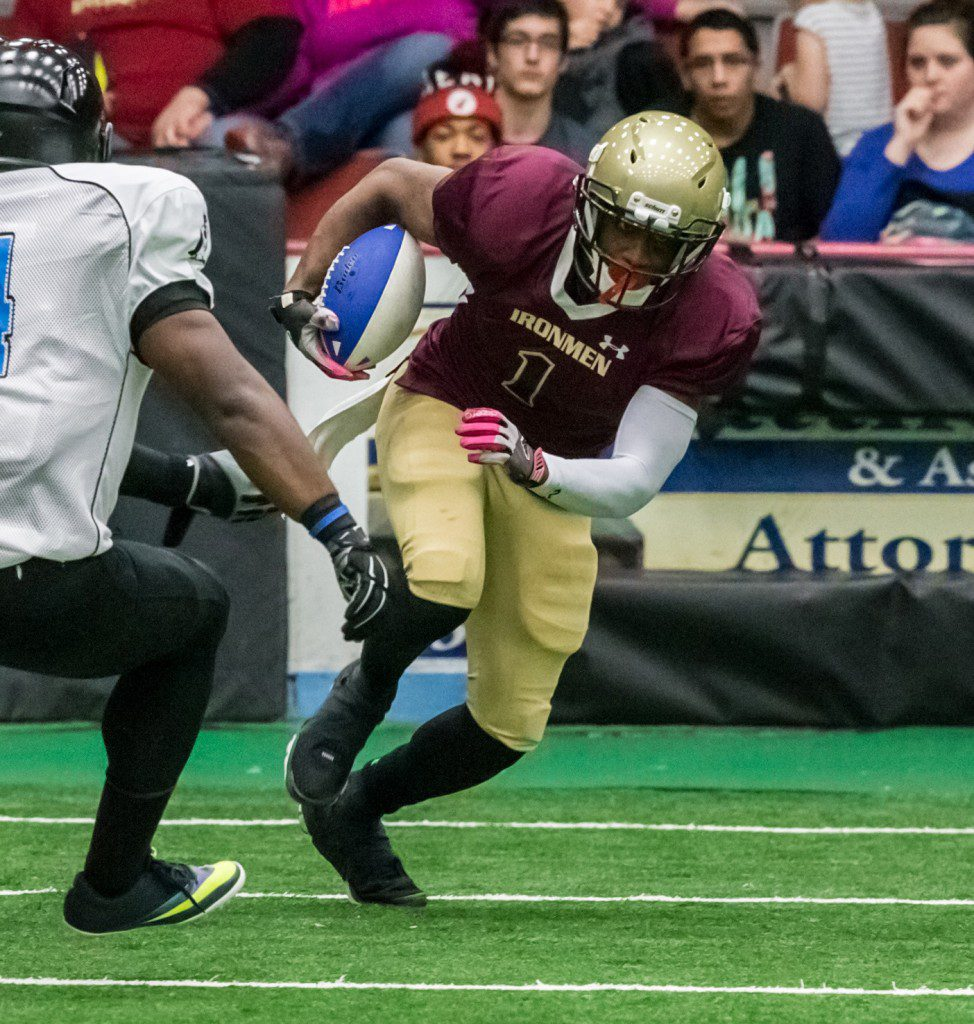 Muskegon grad and Ironmen wide receiver, Corey Johnson, fights for extra yards. Photo/Tim Reilly