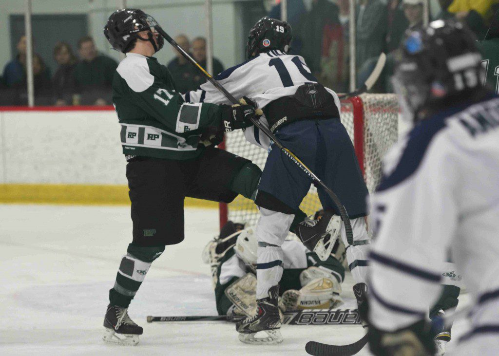 Reeths Puffer's Nate Sullivan (17) and Mona Shores' Zach Tilden (19) get tangled up as the save is made. (Photo/Eric Sturr)