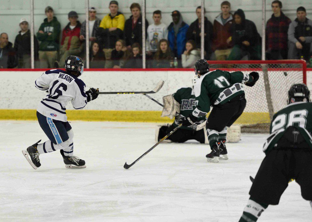 Mona Shores' Elijah Wilson (16) scores top shelf half way through the 3rd period. (Photo/Eric Sturr)