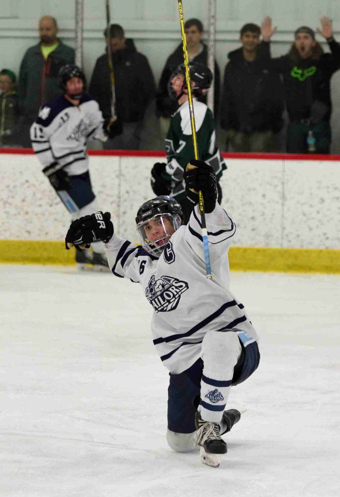 Mona Shores' Elijah Wilson (16) celebrates the team's 5th goal. (Photo/Eric Sturr)