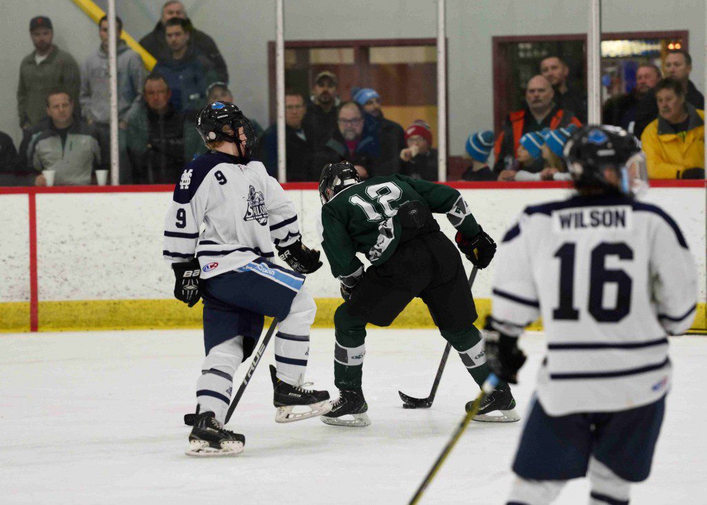 Reeths Puffer's Brody Vanderlinde (12) gets by the Mona Shores' Hunter Meyers (9) and scores on a the backhand. (photo/Eric Sturr)