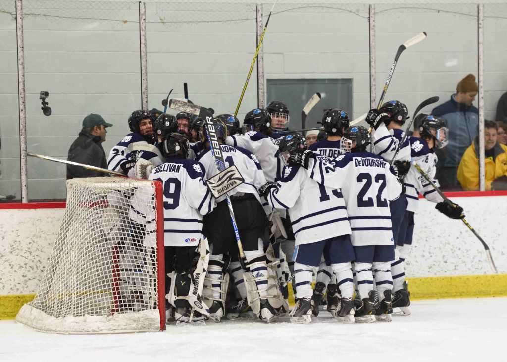 Mona Shores celebrates the 6-5 pre-regional win around goalie Anthony Shrum. (photo/Eric Sturr)