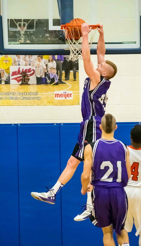 Jeffery Beckman slams home two points for Shelby. Photo/Tim Reilly