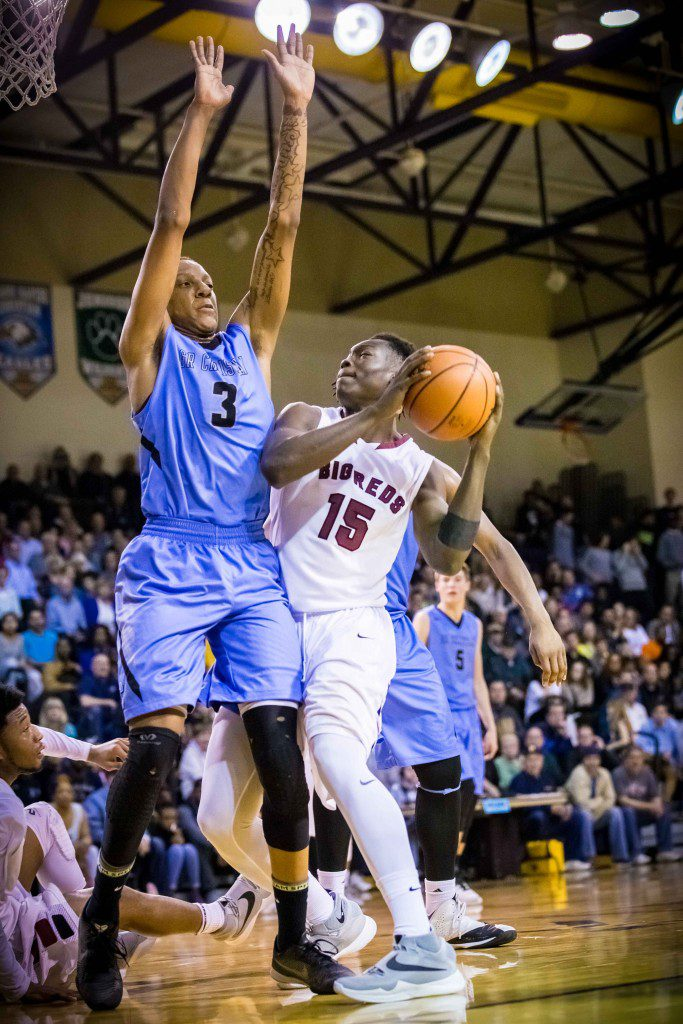 Muskegon #15 Anthony Bethea powers to the hoop as GRC # 3 James Beck defends photo/Tim Reilly