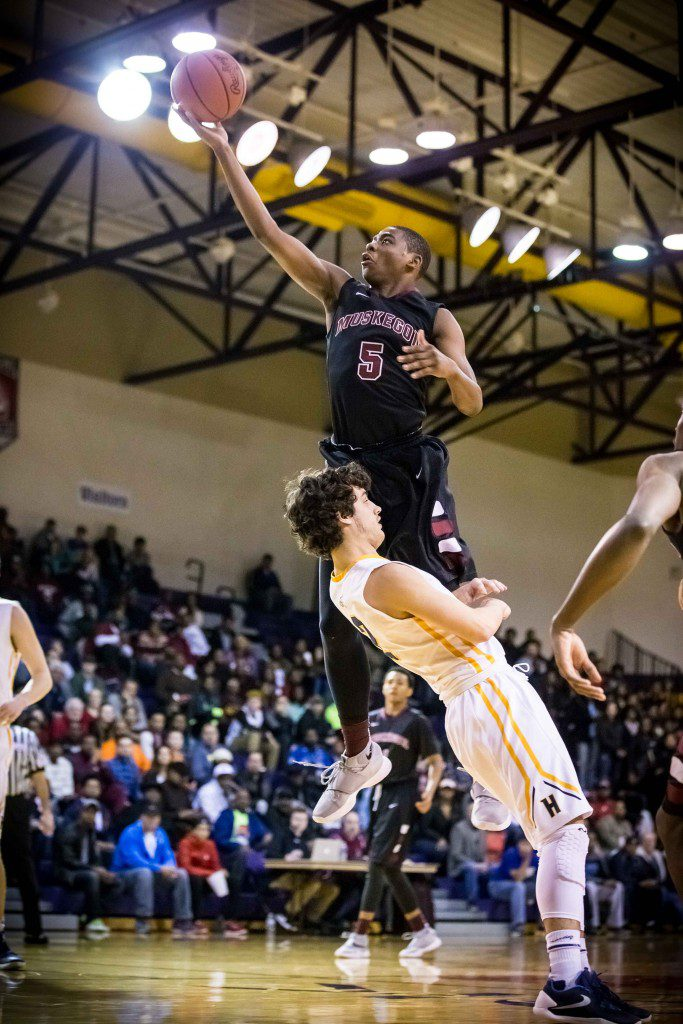 Muskegon #5 Jermane Golidy Skies for two over Hudsonville #2 Jared Blum photo/Tim Reilly