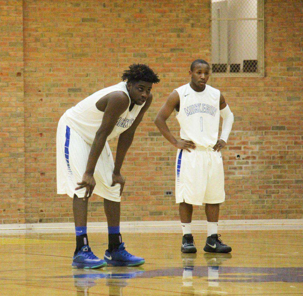 Eddie Tornes (left) and Will Roberson Jr. stand in the back court during a free throw. Photo/Jason Goorman