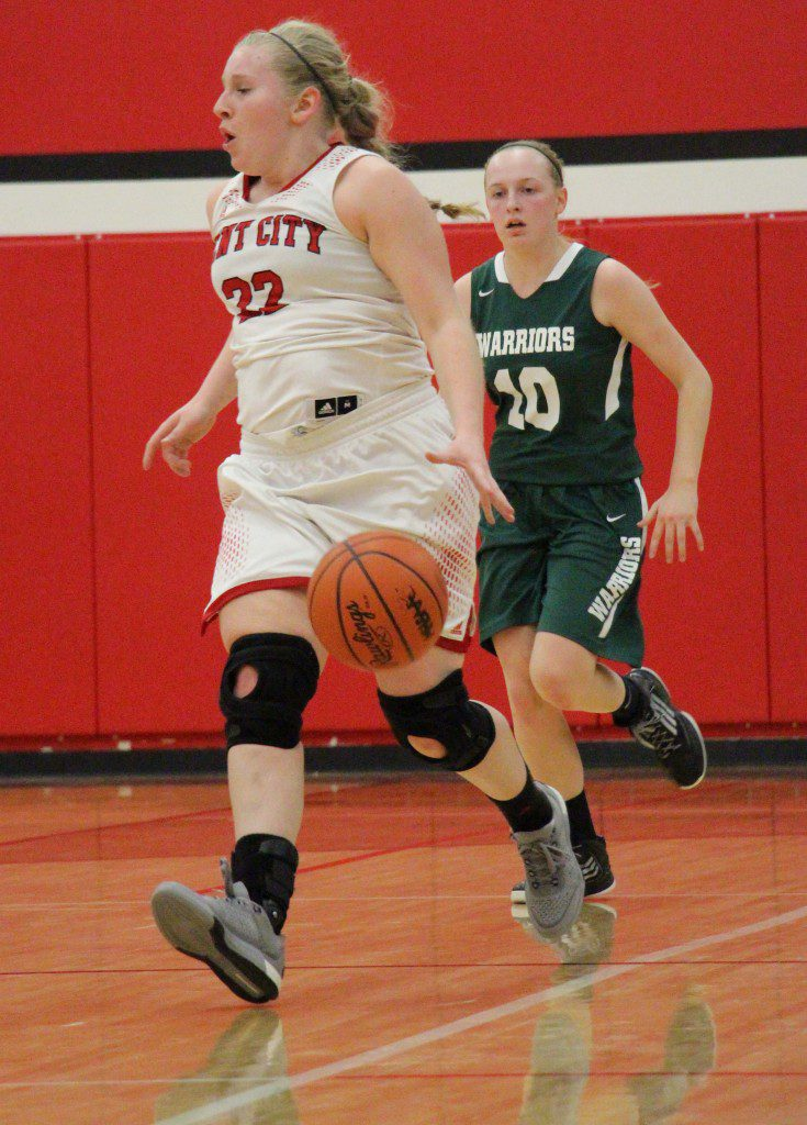 Kent City's No. 22 Meghan Boyd brings the ball up the floor with WMC's no. 10 Haylee Moser pursuing. Photo/Jason Goorman