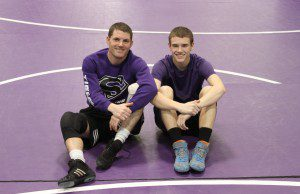 Shelby wrestling coach Ed Felt (left) and his son, regional champ Nick Felt.