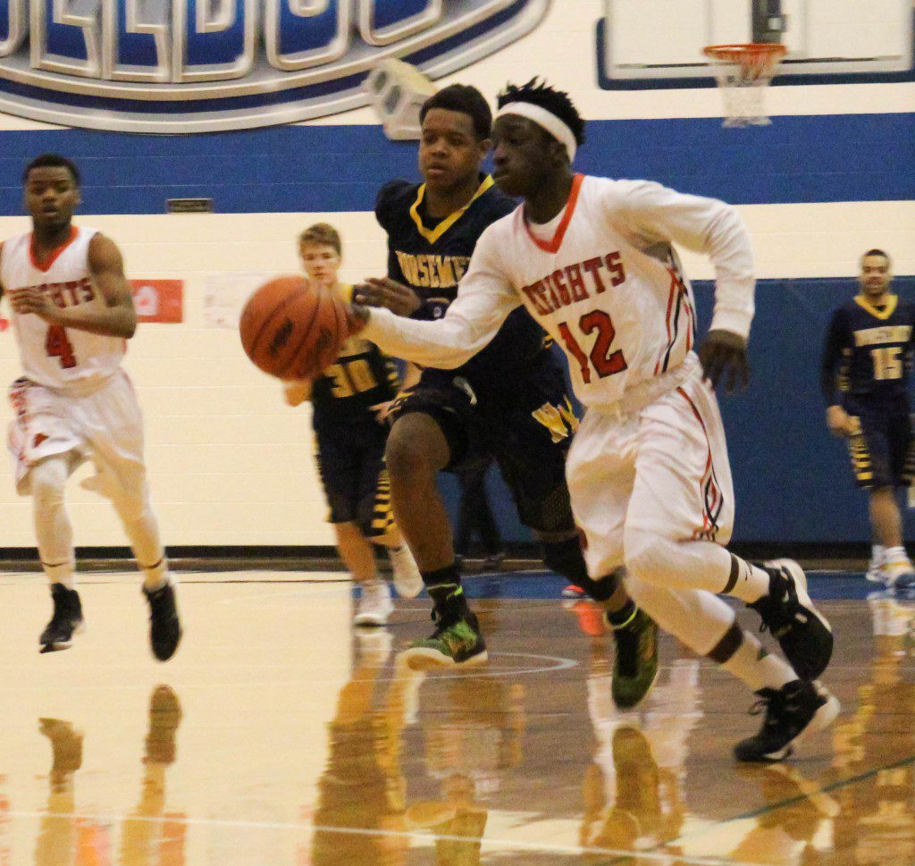 E'onte Tornes gets free on the 2-on-1 for Muskegon Heights in the last seconds of the game. Photo/Jason Goorman