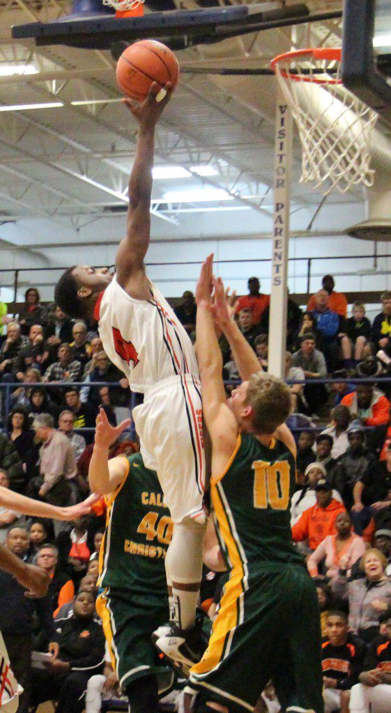 Muskegon Hegiths No. 4 Anthony Jones goes up for two in the lane. Photo/Jason Goorman
