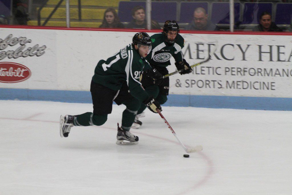 No. 21 Lucas Michaud brings the puck up the ice for the Lumberjacks. Photo/Carol Cooper