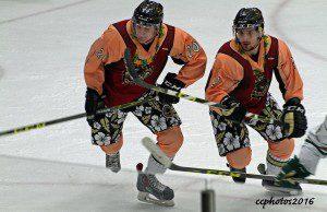 Mitch Eliot and No. 20 Matej Paulovic rush up ice. Photo/Carol Cooper