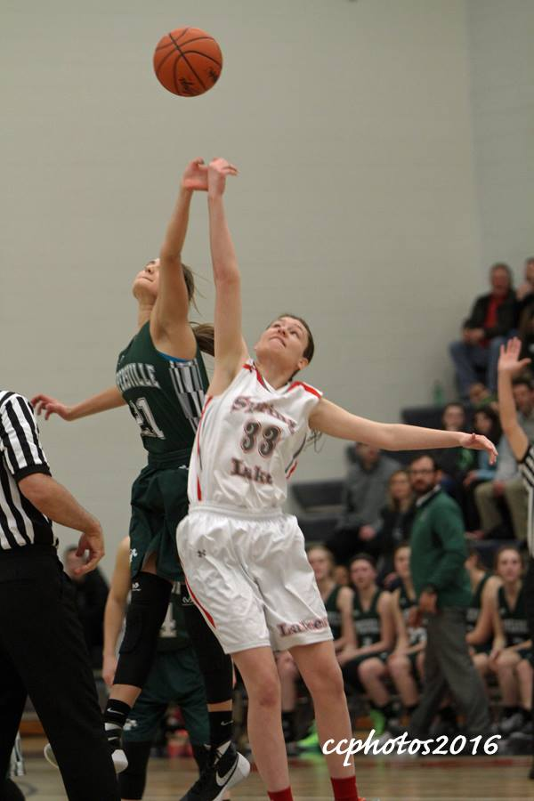 Remi French gets up for the opening tip off. Photo/Carol Cooper
