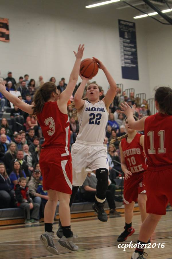 Oakridge guard No. 22 Hannah Reinhold goes up for the shot against Spring Lake's No. 3 Olivia Grimmer. Photo/Carol Cooper