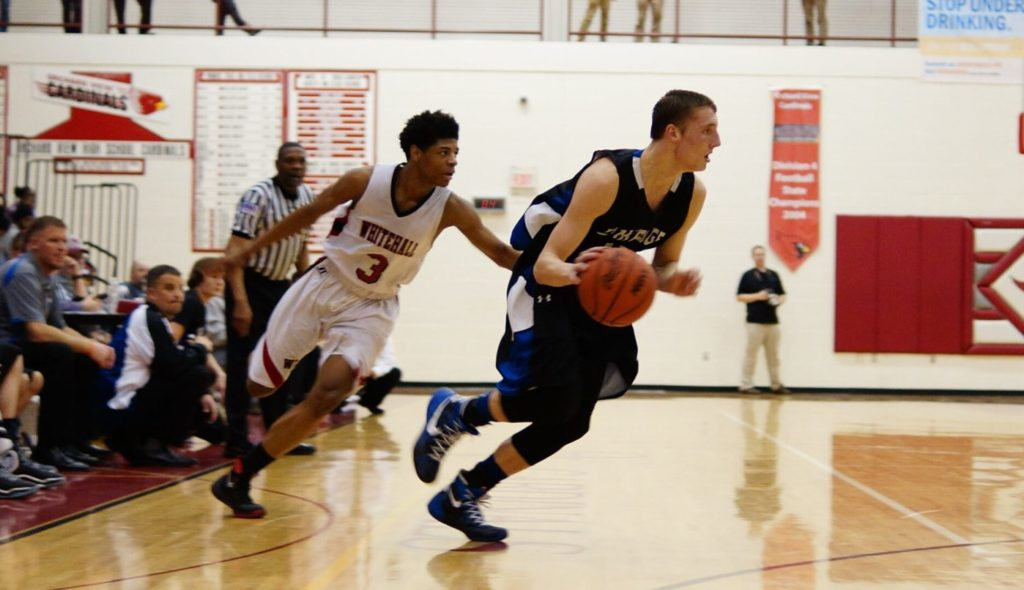 Nate Wahr drives to the basket for Oakridge. Photo/Sherry Wahr