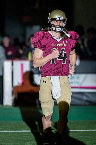 Alex Carder runs on the field during opening productions of the Ironmen preseason opener. Photo/Tim Reilly