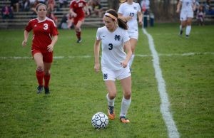 Erin Powers prepares the pass as Spring Lake's Cameryn Veine gets ready to defend. PHoto/Marc Hoeksema