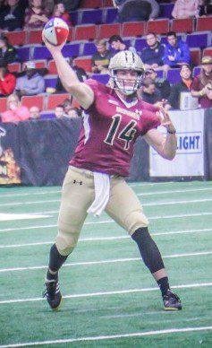 Quarterback Alex Carder makes the pass. Photo/Joe Lane