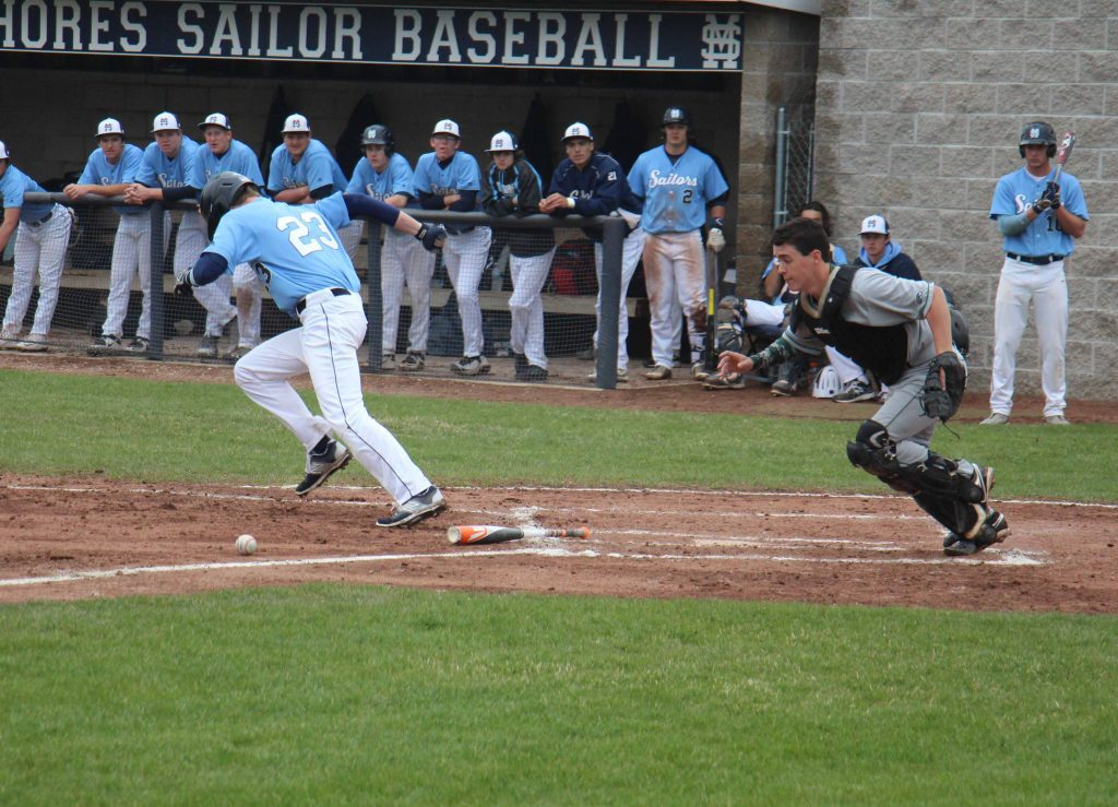 Reeths-Puffer catcher Mikew Luker gets ready to pick up the bunt by Mona Shores' No. 23 Colin Vaughn, Photo/Jason Goorman