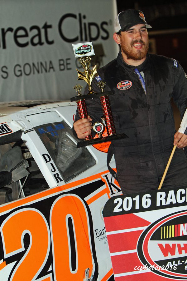 Tyler Nawrocki gets the checkered flag from the Sportsmen Division feature race. Photo/Carol Cooper