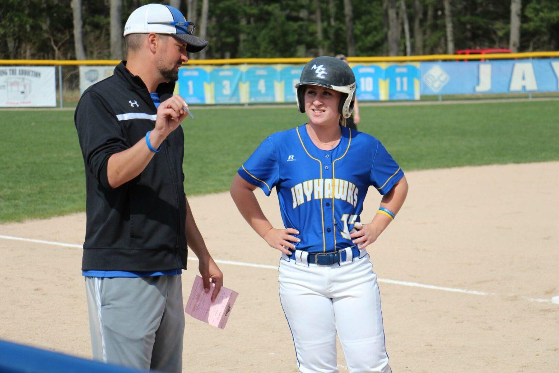 Coach Ryan Schalk talks with Lindsey Helsen at third base. Photo/Steve Gunn