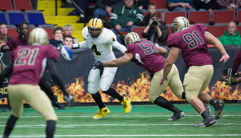 Luther Robinson (52) moves in to hit a Blitz ball carrier. The Western Michigan Ironmen defeat the Chicago Blitz with a final score of 34-30 at the L.C. Walker Arena in Muskegon on Saturday, April 2, 2016