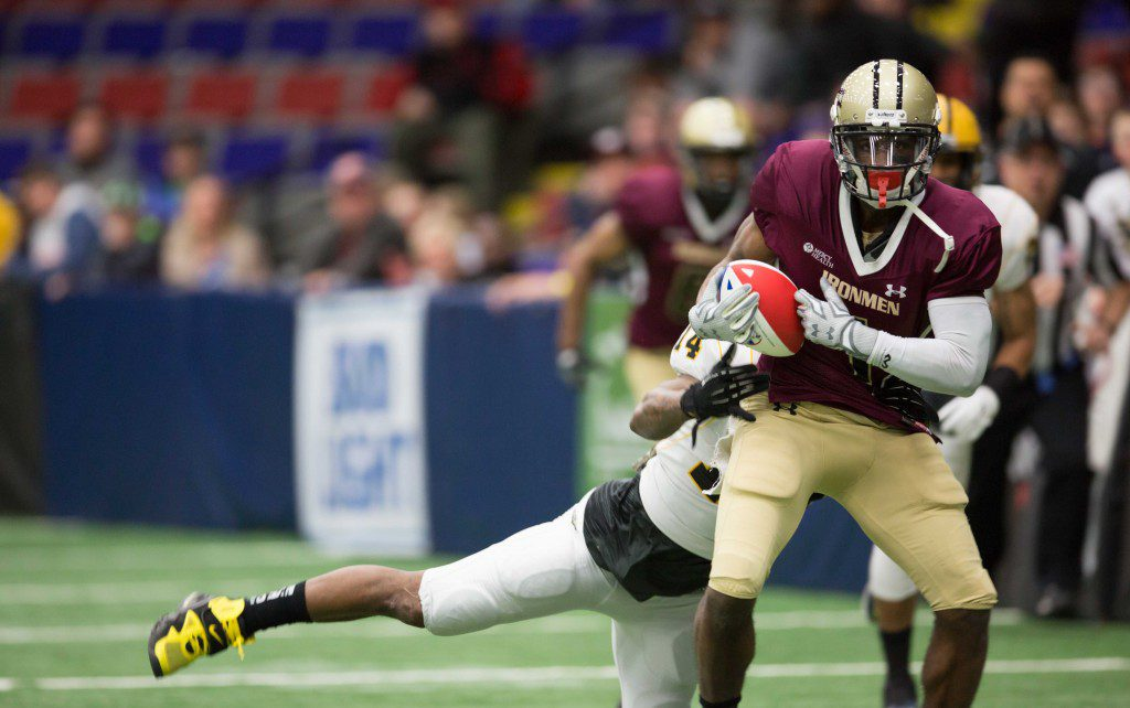 Carnelius Johnson (1) receives a pass, but is brought to the ground shortly after. The Western Michigan Ironmen defeat the Chicago Blitz with a final score of 34-30 at the L.C. Walker Arena in Muskegon on Saturday, April 2, 2016