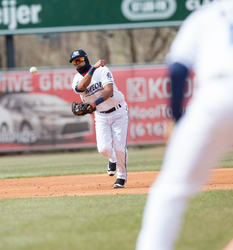 David Gonzalez (10) throws the ball to first base to get the last out of the inning.