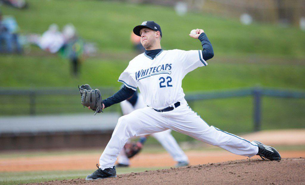 Starting pitcher Matt Hall (22) throws a pitch toward home plate.