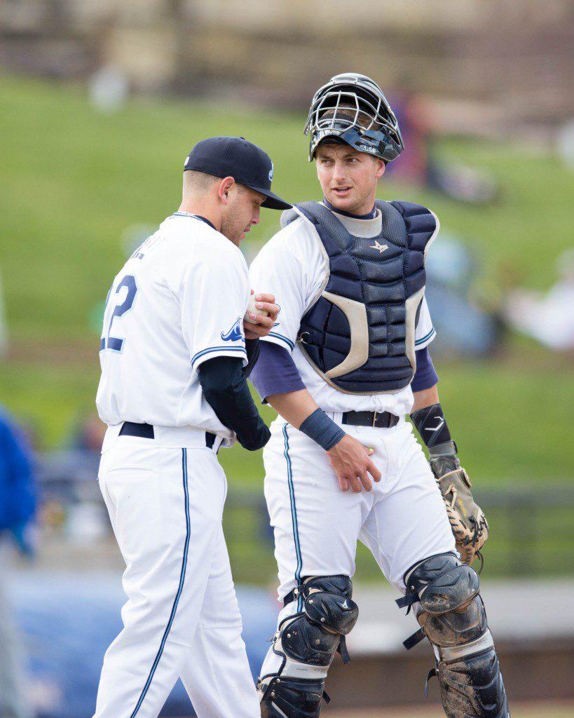 Catcher Shane Zeile (9) and starting pitcher Matt Hall (22) meet briefly on the mound. Photo/Kevin Sielaff.