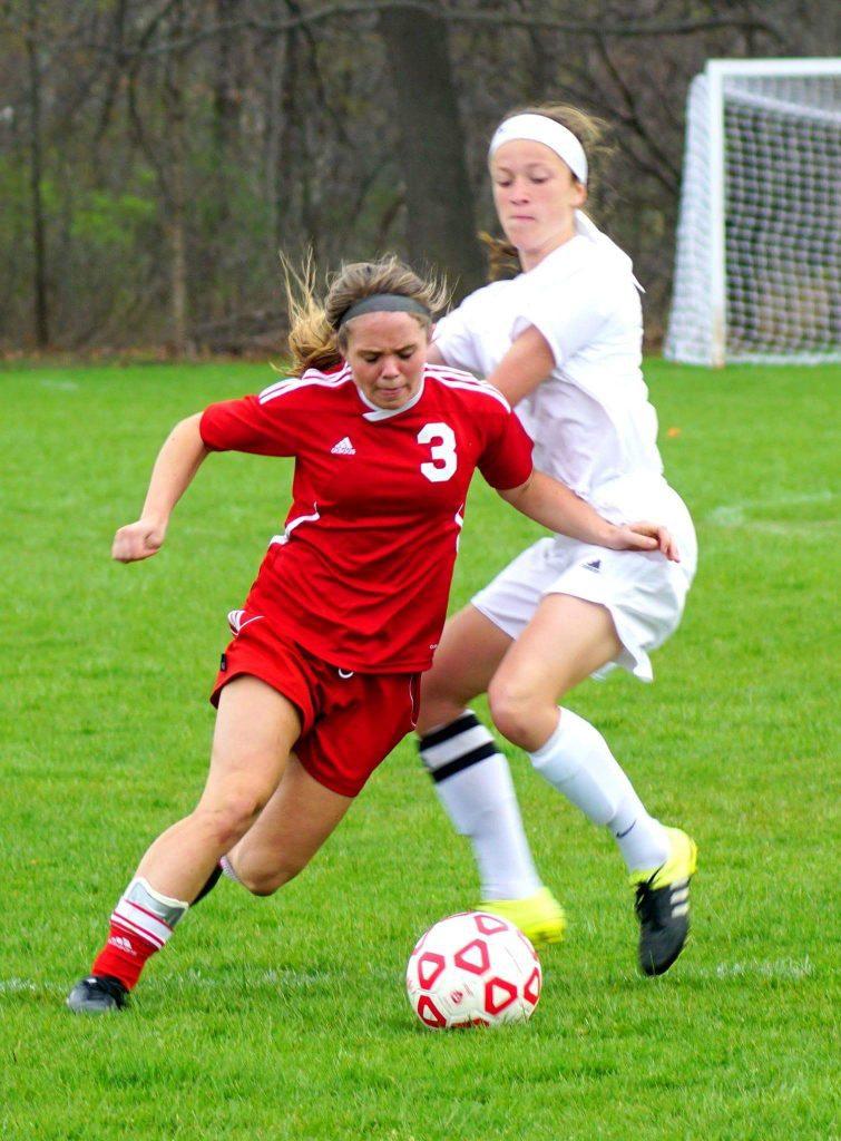 Emily Batts gets dribbles around MCC's Talia Tyler. Photo/Leo Valdez