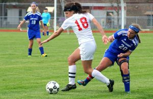 Whitehall's Lauren Lopez (18) gets the ball away from Mackayla Zimmer. Photo/Leo Valdez