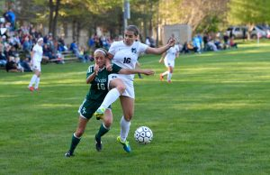 Reeths Puffer's Jenna Stolzman and Mona Shores' Isabel Grace battle for possession. Photo/Eric Sturr