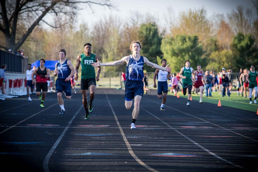 Fruitport's Noah Hendricks crosses the finish line first in the 400. Photo/Tim Reilly