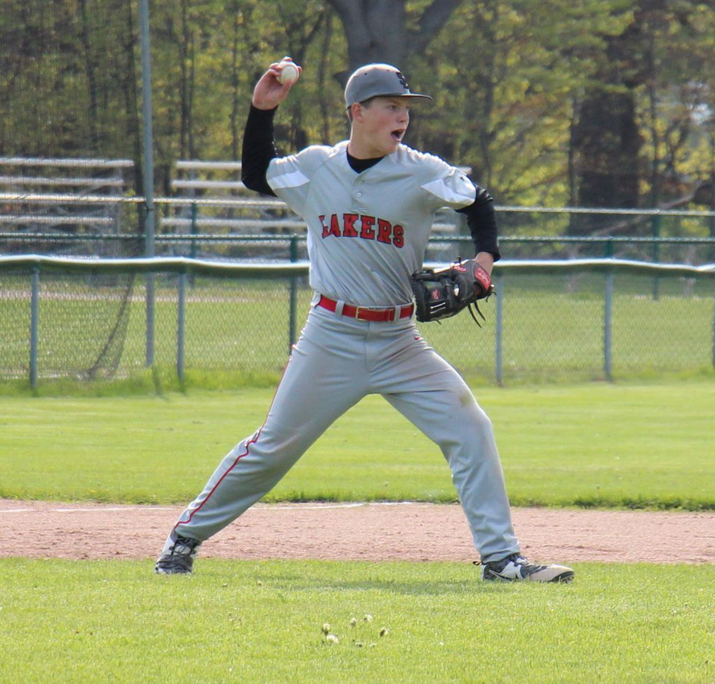 Spring Lake third baseman David Kumptz fires the ball around the infield after a Gray strikeout. Photo/Jason Goorman