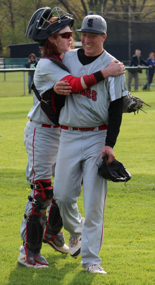 Gray Christian hugs pitcher Jacob Gray after the win. Photo/Jason Goorman