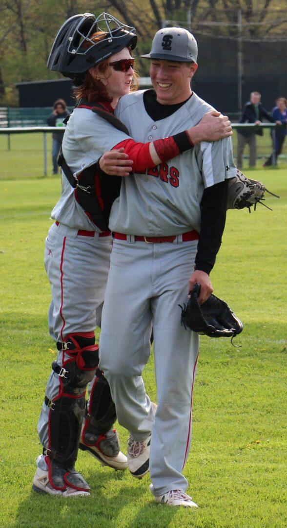 Gray Christian hugs pitcher Jacob Gray after the win. Photo/Jason Goorman