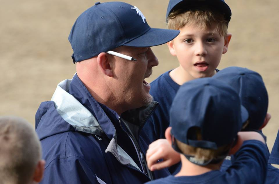 Butch Grimm gives his players a pep talk. Photo/Marc Hoeksema