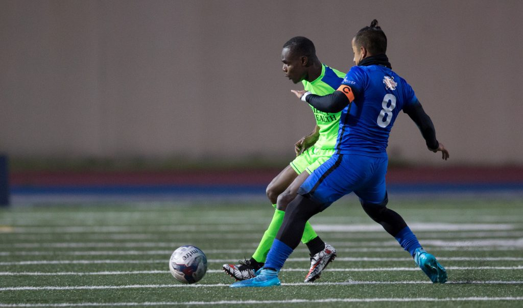 Daniel Luzindya (10) meets Lito Esquivel (8) of GRFC at midfield and fights for the ball in a game last Saturday, May 15 . Photo / Kevin Sielaff